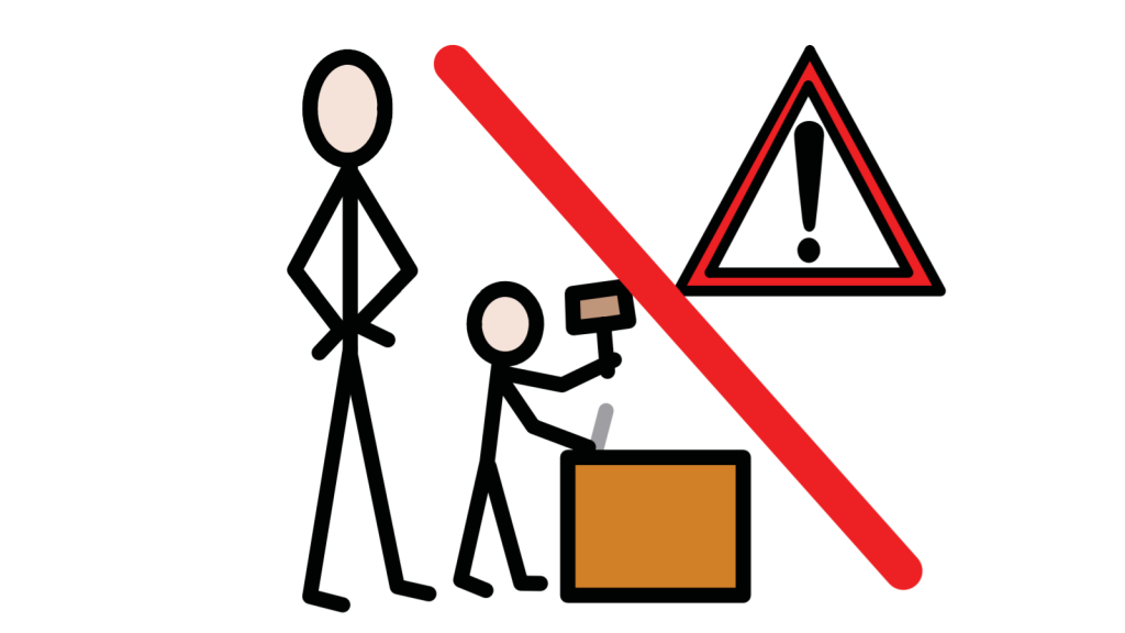 A child hammers a nail as an adult watches. There's a hazard symbol beside this, and the whole image has a red line struck through it.
