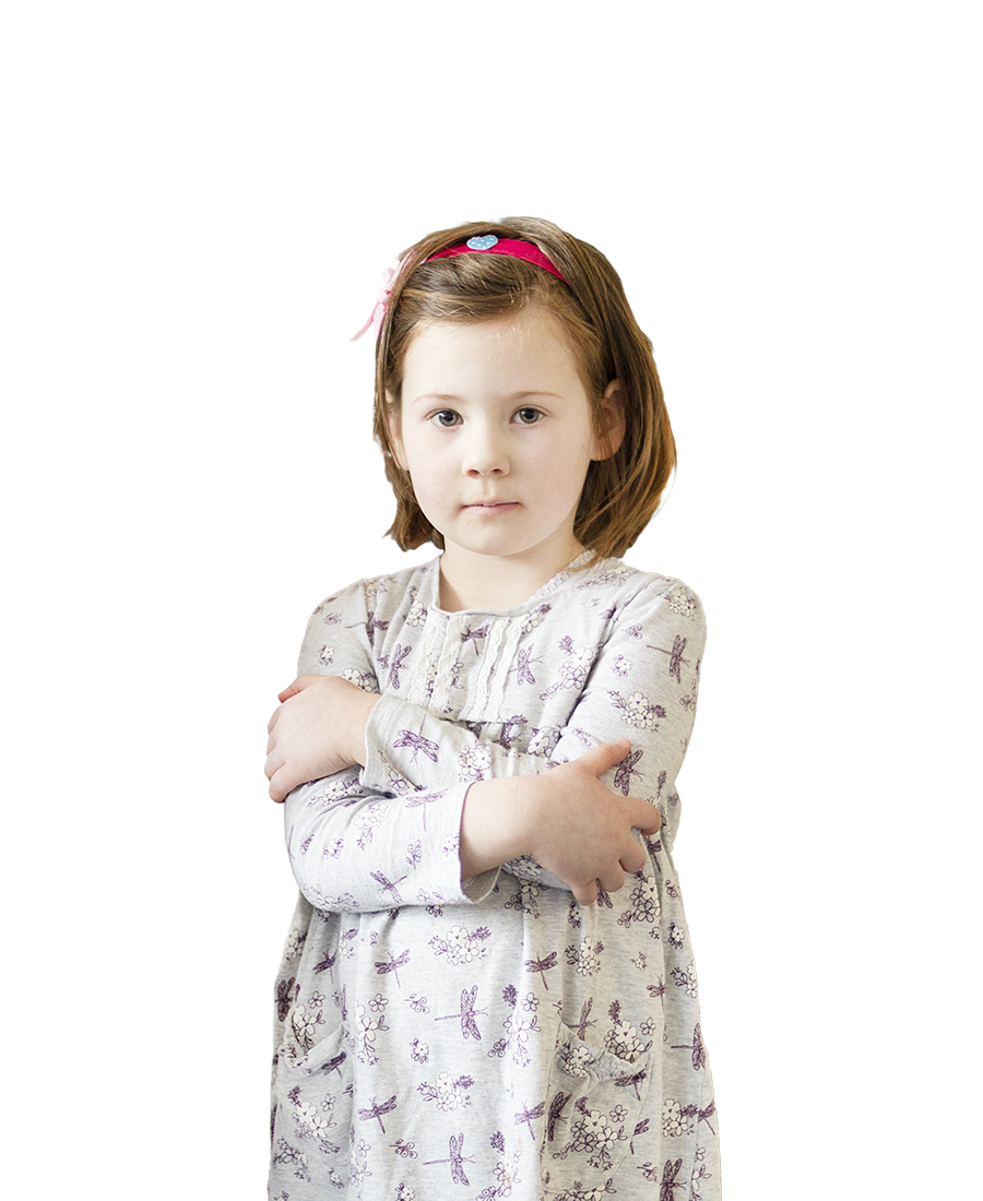 image of young girl with arms crossed.