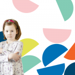 Young girl with colourful shapes behind her.