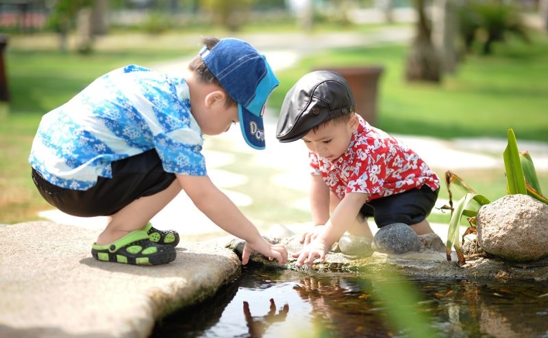 Picture of two boys playing in water.