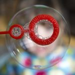 A soap bubble being blown.