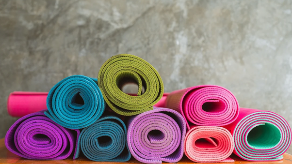 A pile of rolled up yoga mats.