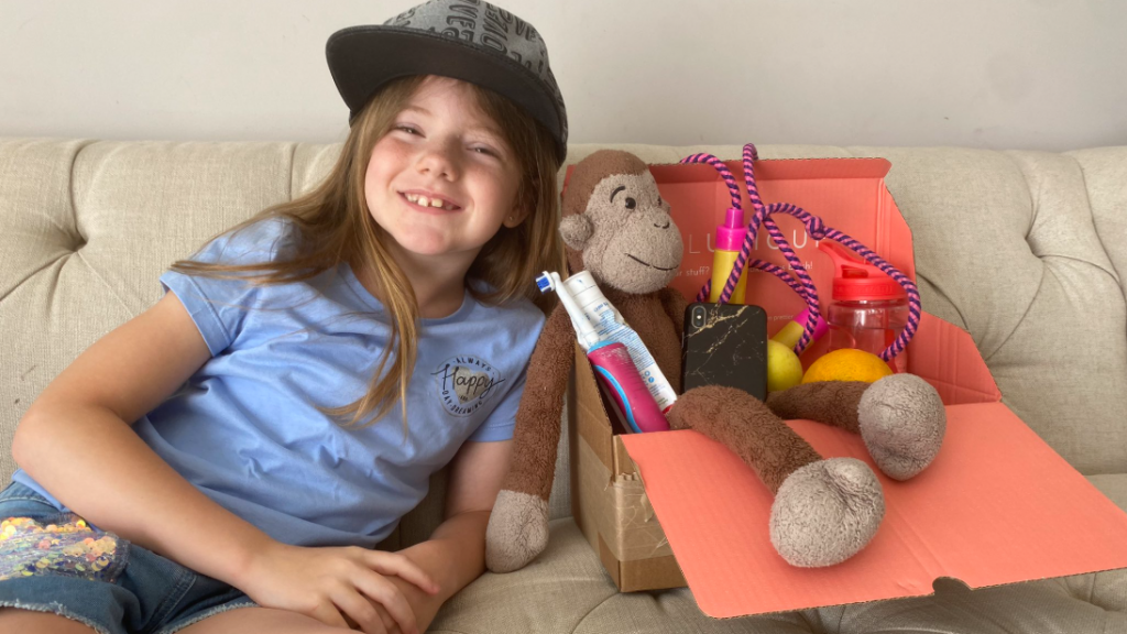Eva with her treasure chest full of the things that keep her healthy and well.