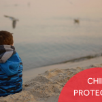 """A small boy on a beach looking out to sea, with the caption """"Child Protection."""""""